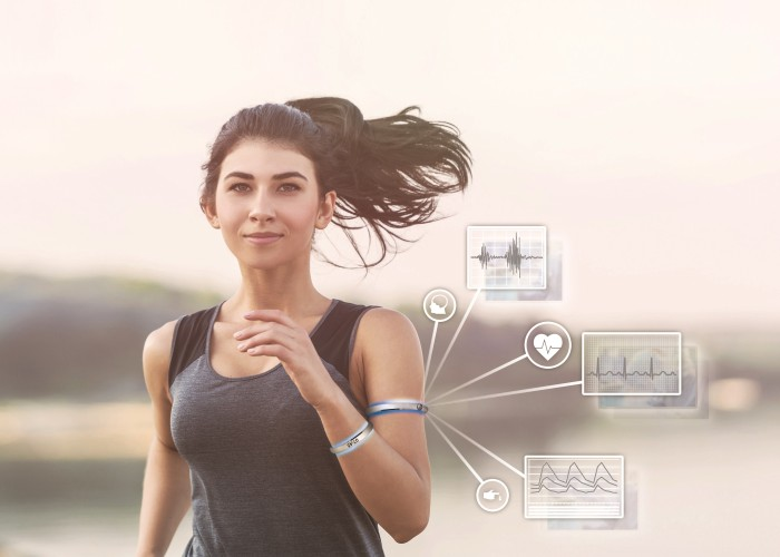 Woman running with wearables
